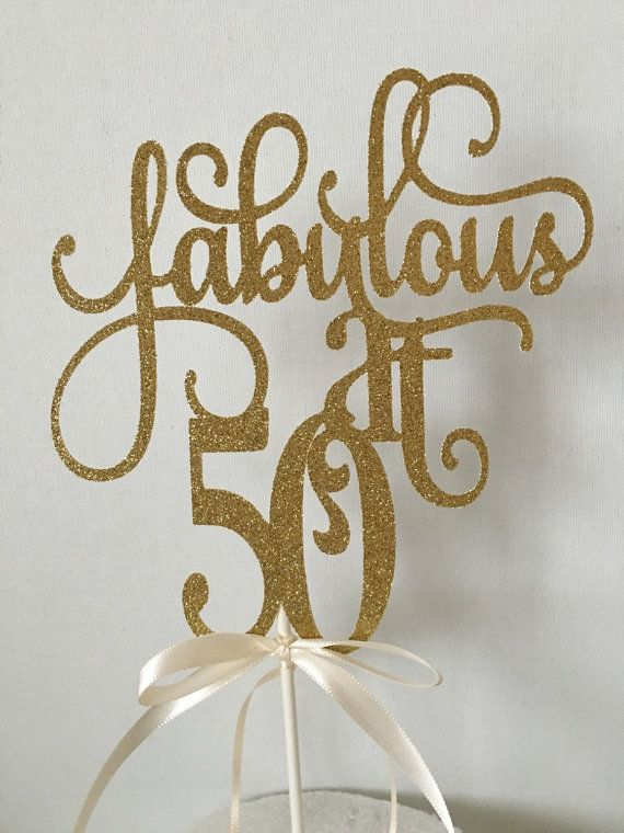 This adorable Fabulous at 50 cake topper is perfect for your party. This sparkly topper will WOW everyone. The cake topper features words Fabulous at 50 in a cursive font. Designed using premium glitter paper card stock and on a shimmering ivory backing. Finished with satin ribbons - attached with food safe lollipop stick.  Size: 6.5 height Approx.  6 width Approx. With the lollipop stick - 10 Approx.  Please keep in mind that this is made with a heavy duty card stock but it is a more…