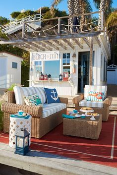 We could get used to a setting like this. How about you? Pier 1's versatile, durable Echo Beach Collection is now available in a casual, roll arm version. Handcrafted of all-weather wicker over a rust-resistant metal frame, this modern design works beautifully with many outdoor styles, like this coastal look!