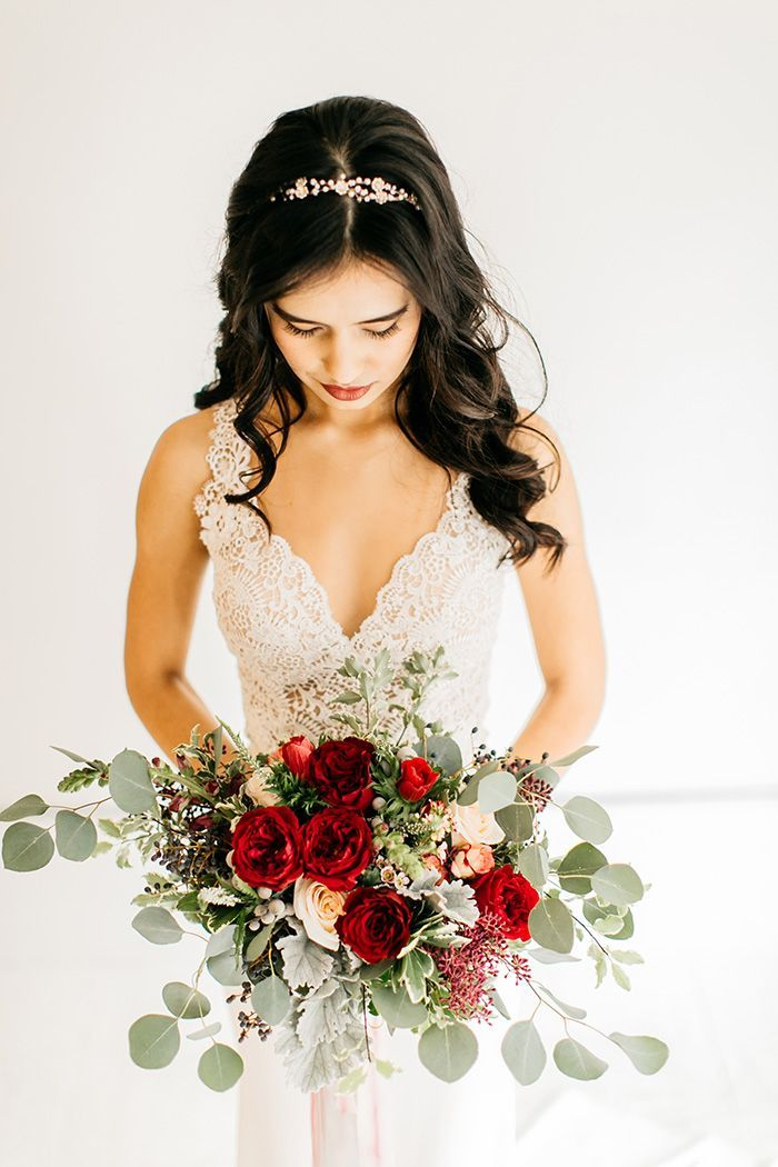 Romantic Lace Wedding Dress With A Red And Greenery Bouquet Red Wedding Dresses Minimalist Wedding Dresses Modern Bridal Bouquets