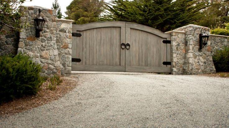 massive gate on gravel driveway