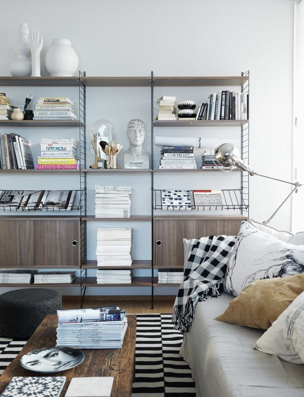 Love the wall unit and textiles