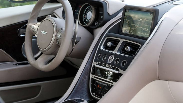 2017 Aston Martin DB11 interior with steering wheel and infotainment