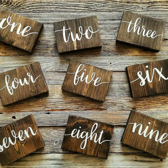 Garter Girl Loves: These rustic wooden table numbers