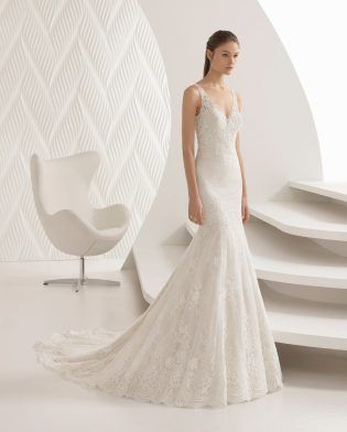 Rosa Clara- ACUARIO  This mermaid-style lace wedding dress evokes nature's beauty. The open back gives it a powerful sensuality while the V-neckline deeply flatters.