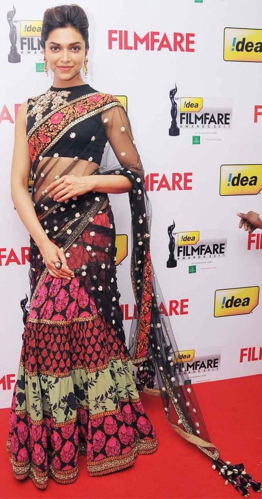 Deepika Padukone - Unique sari with a ghagra-style skirt and printed layers.