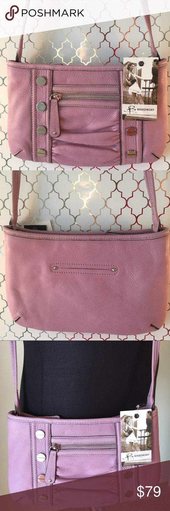 🆕B. MAKOWSKY NEW LAVENDER CROSSBODY 💯AUTHENTIC B. MAKOWSKY NEW BEAUTIFUL LAVENDER LEATHER CROSSBODY BAG 💯AUTHENTIC. STUNNING SNE STYLISH TOTALLY ON TREND. SUPER SOFT GENUINE LEATHER. PURCHASED AND WAS NEVER USED. SO BEAUTIFUL IN PALE LAVENDER! THIS GREAT BAG HAS TWO OUTSIDE POCKETS! INSIDE IS A GREAT ZIP WALL POCKET. THIS STUNNING BAG ALSO HAS A ZIP TOP CLOSURE TO KEEP YOUR ITEMS SAFE . THE BAG MEASURES ALMOST 11 INCHES WIDE AND ALMOST 7 INCHES TALL. THE PERFECT BAG! THE LOVELY CROSSBODY…