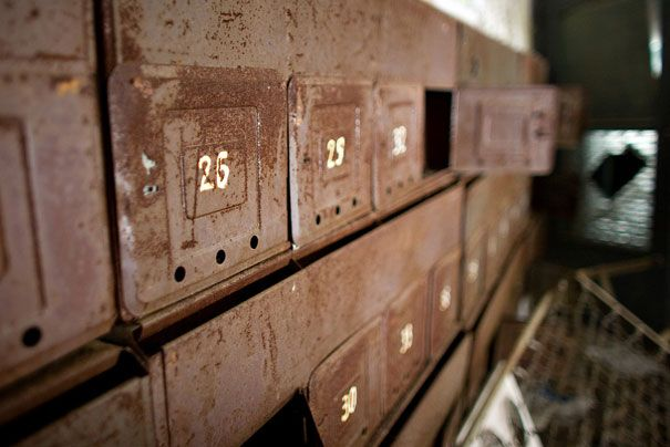 Mailboxes in an abandoned Pripyat apartment building.  (photo credit: http://www.flickr.com/photos/pedromourapinheiro/ )