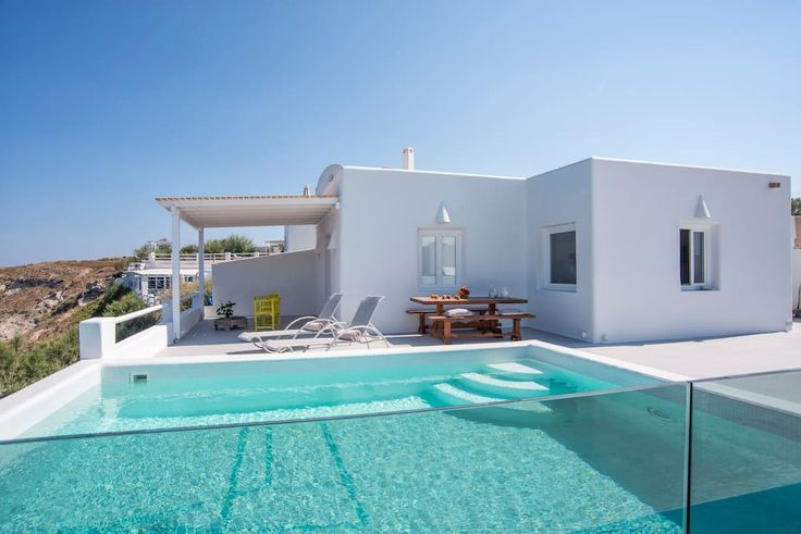 in Santorini, GR. The Villa has two bedrooms, 2 bathrooms and an open-plan living room with kitchen. Each bedroom is air-conditioned and comes with a built-in double bed & LCD SAT TV. Bathrooms are charmingly decorated with a Santorinian style shower room.