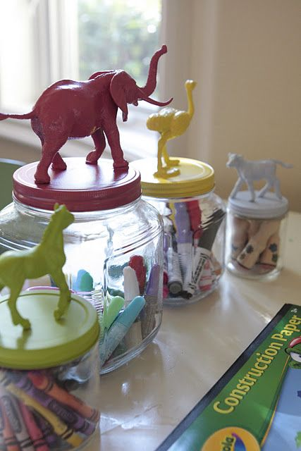 Such a great idea! Super glue plastic toys to the lids of jars, then spray paint. For a ceramic look, I used smaller animals & sprayed about five coats (allow to dry between coats) of high gloss white spray paint.