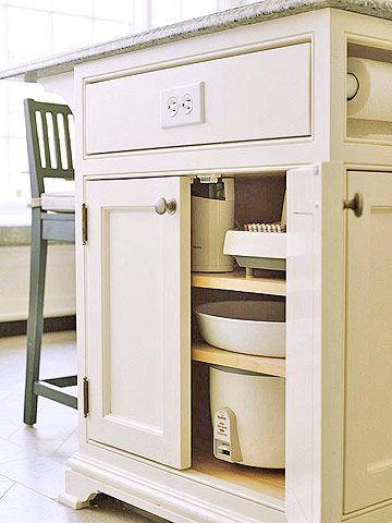 •Island Hideaway   Small appliances can also be tucked away in traditional cabinetry. Stored at the end of an island, equipment is accessible but out of sight. This location is perfect for seasonal items.