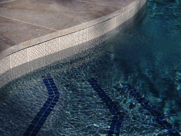 Amber Tiles Kellyville: white tile waterline with Platinum Travertine coping. #whitemosaic #poolmosaic #poolinspiration #naturalstone #travertine #ambertiles #ambertileskellyville Photo Cred: Amber Tiles Mona Vale