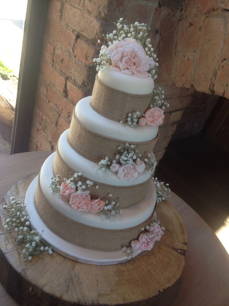 Rustic hessian stunning wedding cake four tiers with baby breath and iced peonies