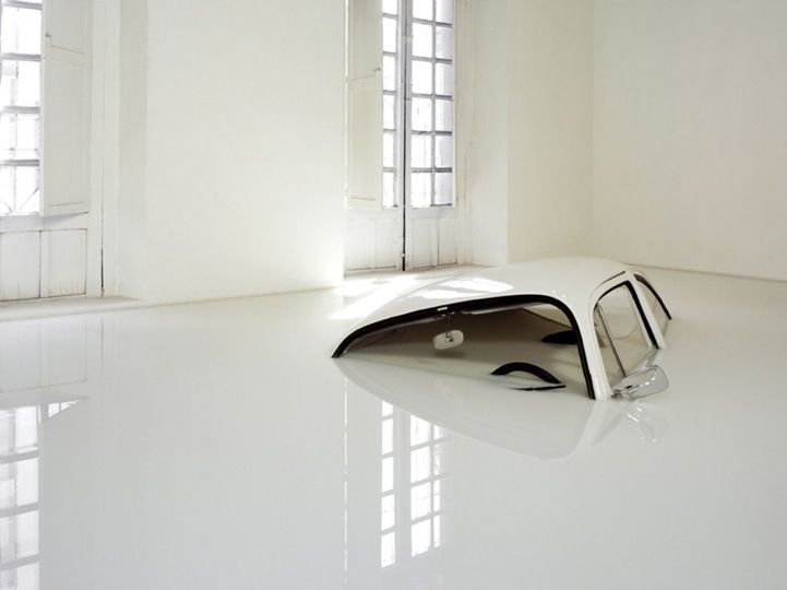 Mexican-born artist Ivan Puig plays with perspective and ordinary objects. VW Bug in Milk.
