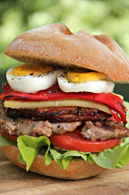 Like hamburgers? Then you will love a chivito steak sandwich, the great sandwich of Uruguay. Crammed with fillet steak, bacon, cheese, onions. A classic.  www.compassandfork.com