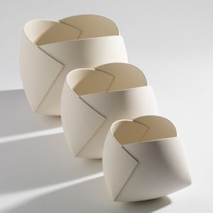 J. Lohmann Gallery, Ann Van Hoey is an industrial designer gone ceramic artist who takes paper to pottery, creating ceramic bowls in the form of origami paper folding.