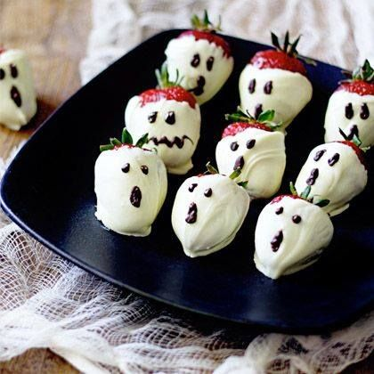 Halloween Treats And Sweets Ghosts made from strawberries and chocolate