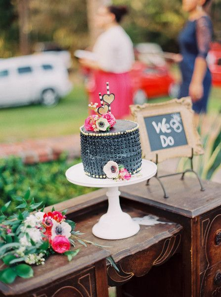 Unique and modern wedding cake idea - petite, black-frosted wedding cake with gold and pink details {Michelle March}