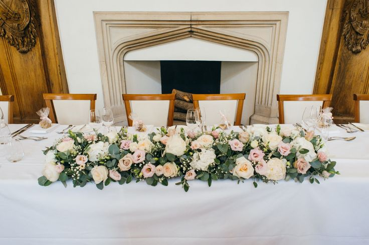 Boutique Blooms: Boutique Blooms Floral Design & Styling Delicate soft pink and white rose top table display at Farnham Castle. Photo credit: Babb Photo