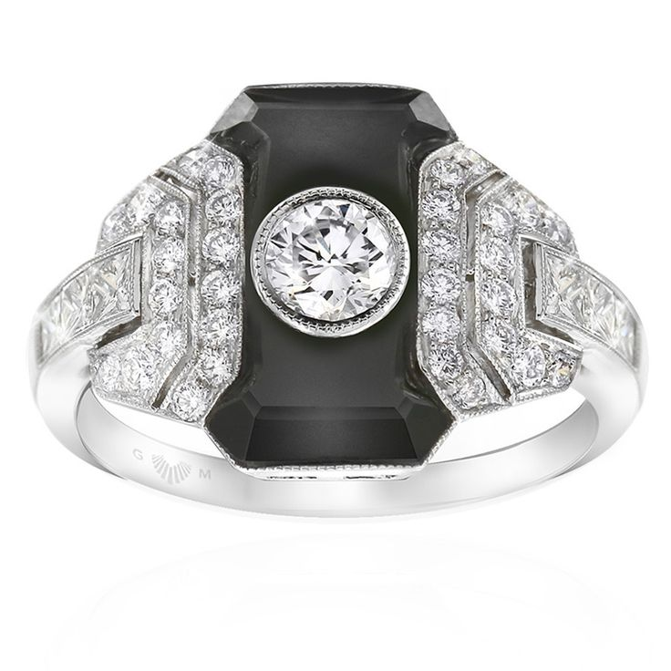 Noir onyx and diamond dress ring. Inspired by the striking geometric designs of the Art Deco period. Featuring a precision cut piece of black onyx and brilliant white diamonds. Embellished with mille graining around the diamonds and crafted in Platinum. This ring will be customised to perfectly fit your finger, which may take up to 6 weeks.