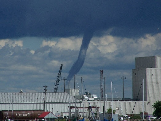 Is a waterspout a tornado? Can it do damage on land? Our experts untwist the mystery.