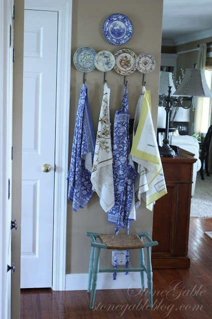 add hooks to old plates. (Use white plates with numbers on them or initials and hang my holiday aprons on)