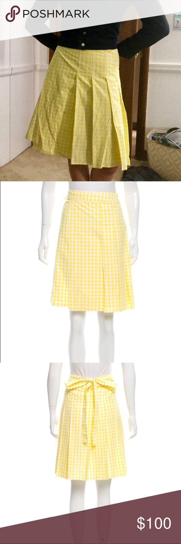 Burberry Gingham Wrap Skirt Yellow and white gingham cotton wrap skirt. GUC, just a few wrinkles from storage. This is a size 6, but since it's a wrap, I personally think it could fit a small or medium. Burberry Skirts A-Line or Full