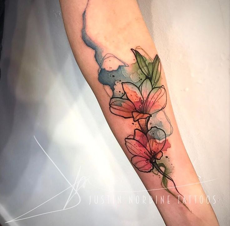 Justin Nordine Watercolor flower tattoo