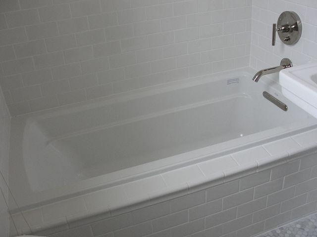 Kohler archer drop in tub with daltile subway tile in for Daltile bathroom ideas