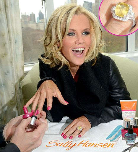 Jenny McCarthy:  a large yellow sapphire in a diamond halo!