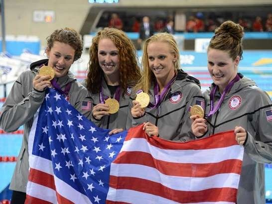 Missy Franklin , Dana Vollmer , Shannon Vreeland , and Allison Schmitt with their gold medal after the women's 4x200 relay during the London 2012 Olympic Games