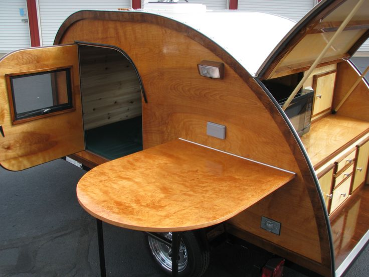 Our Retro Teardrop Camper and side table in a light finish. Buy already built or build your own www.bigwoodycampers.com