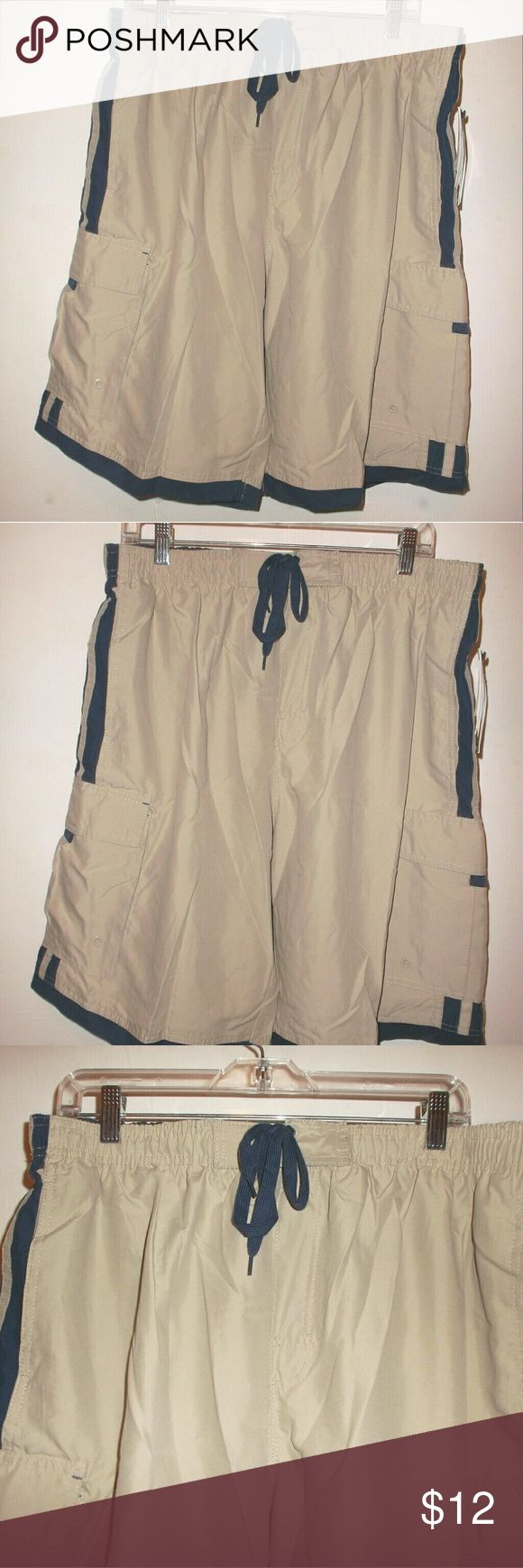 """Quick Dry Swim Trunks Mens Large NWT A new with tags pair of Burnside swim Trunks!   Mens size Large.   100 % polyester quick dry fabric.   Beige in color called """"stone"""" on the tag.   Front pockets and Velcro close leg pockets.   Mesh underwear lined.   Inseam is 10 inches   Bundle and save 20 %! Burnside Swim Swim Trunks"""