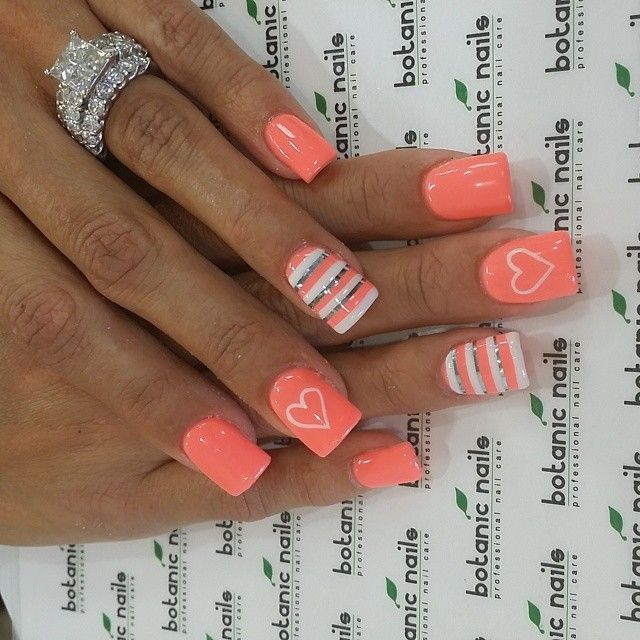 This cute nail design features an elegant stripe design on the ring finger and a super pretty coral color on all the other nails! Enjoy! #nail