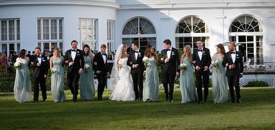 The Greenbrier wedding party photo.  We used J Crew dusty shale bridesmaids dresses and tuxes from The Black Tux