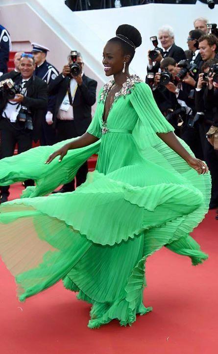 Lupita looking stunning in green!
