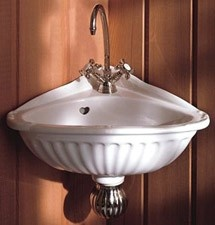 pretty little corner sink! perfect for a tiny powder room....