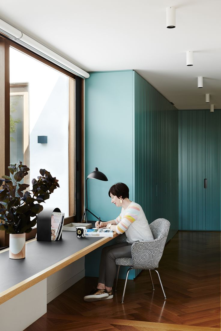 Study with teal cabinetry and Forbo furniture linoleum desk in modernist home in Melbourne's inner south-east. Photography: Annette O'Brien | Stylist: Becky Littler | Story: Australian House & Garden