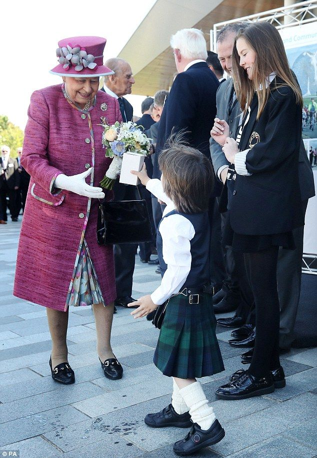 The Queen receives a bouquet of flowers from five-year-old Sam Mitchell.Later on, Her Majesty is due to meet Canadian Prime Minister Justin Trudeau in Edinburgh