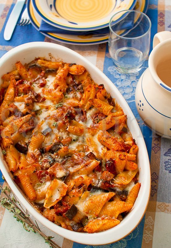 Italian oven-baked pasta with eggplant and sun-dried tomatoes.