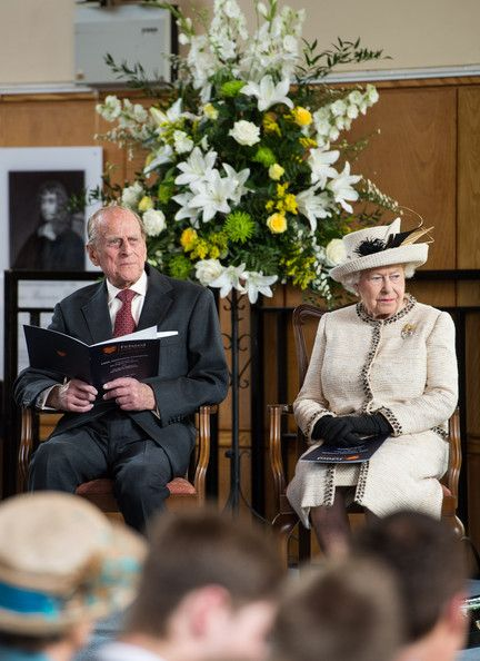 Prince Phillip, Duke of Edinburgh and Queen Elizabeth II sit on stage during their official visit to Felsted School on May 6, 2014