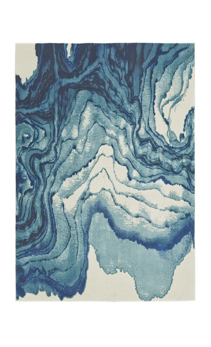 Why settle for a simple area rug when you can elevate your look with a watercolor-inspired print?