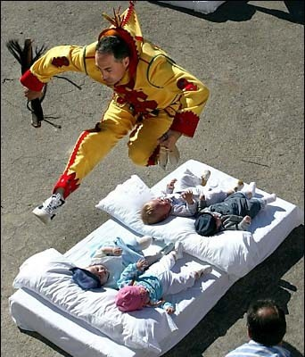 El Colacho, Spain  El Colacho is a bizarre spanish festival where men dressed as devils jump over babies lying on streets on mattresses. The aim is to purify the babies of all sins.  El Colacho is one of the bizarre festivals in the world. Do comment if you know more. :)