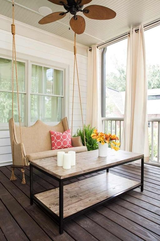 A dreamy porch isn't complete without a gorgeous swing and a set of curtains to keep things cool and breezy.