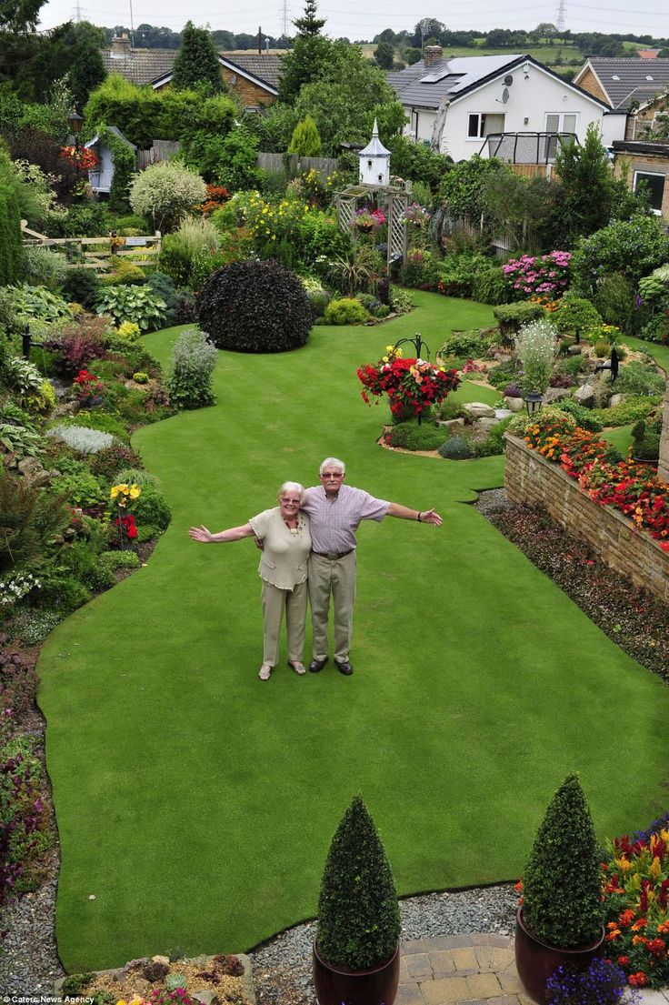 Lovely Anne And Stuart Grindle Stand On The Hallowed Turf, Proudly Showing Off  Their Immaculate Garden