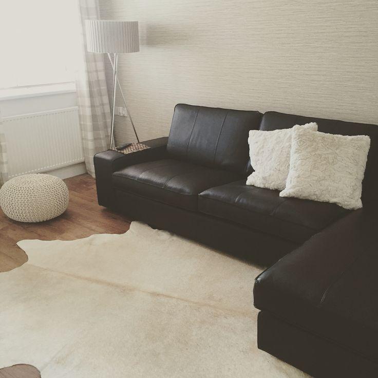 Finally finished! IKEA kivik leather sofa, cowhide rug, knitted pouffe, tripod lamp, sea grass wallpaper