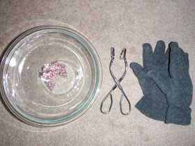 Kids are handed a set of tongs, a pair of thin winter gloves and kisses in a jar. They have to get the kisses out and unwrap them using only...