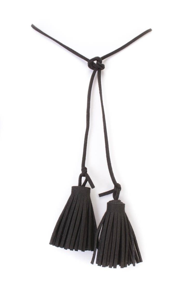 Stay ahead of the trend with this necklace! Featuring faux suede fabric, tassel accent, followed by a knotted closure.