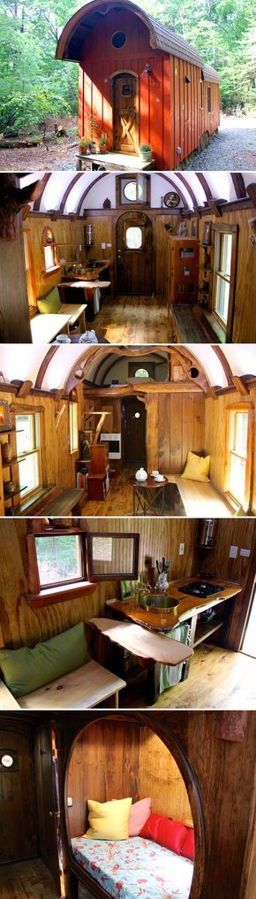 A one-of-a-kind tiny house with a curved roof, round windows, live edge maple desk, mahogany storage staircase, and intricate woodwork throughout.