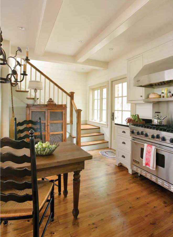 Don't you usually see two staircases in older southern homes?  Either way, I like the idea of having a staircase that comes into the kitchen, in addition to a more formal staircase towards the front of the house.