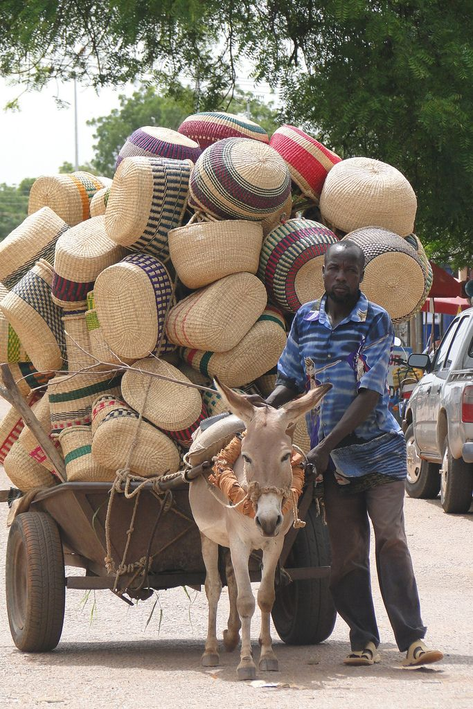 I choose to believe that my ghana basket was once on a cart like this :)  Africa | Basket vendor in Bolgataga. GHANA.